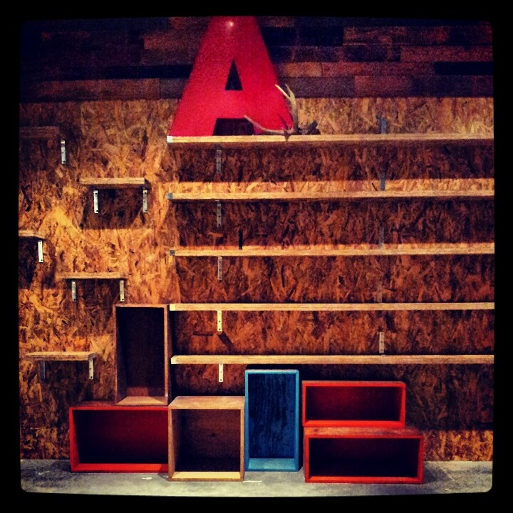 Akkolade shoe wall.Reclaimed wood & OSB.