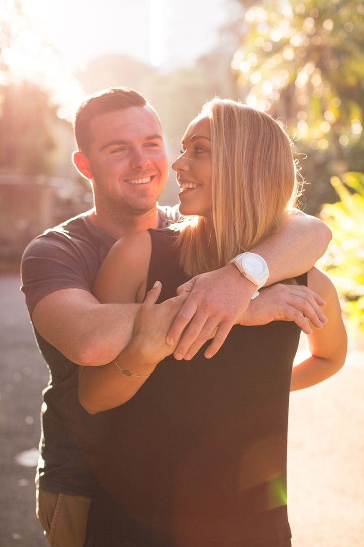 Backlit smiling couple. blonde happy and embracing. Ideas for couples posing.