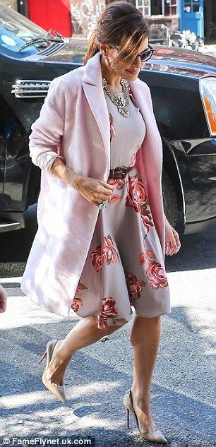 Classic: The Latina actress looked like a 1950s Hollywood star in her girly floral dress and bubblegum pink coat as she stepped carefully fr...