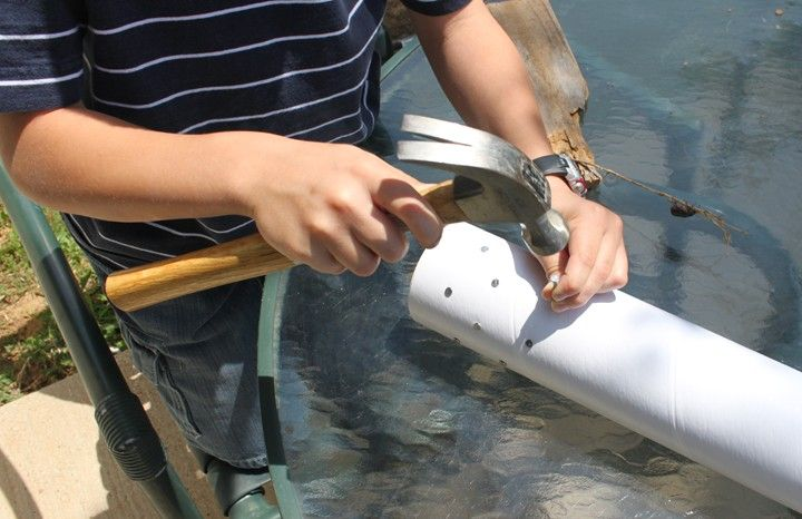 Make a rain stick out of a mailing tube.  Looks like a fun project with lots of hammering!