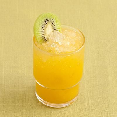 Southern Pineapple Punch | Tropical flavor abounds in this mixture of pineapple, orange, and mango juices. The fruit, spice, and whiskey in Southern Comfort liqueur complete the flavor. | SouthernLiving.com