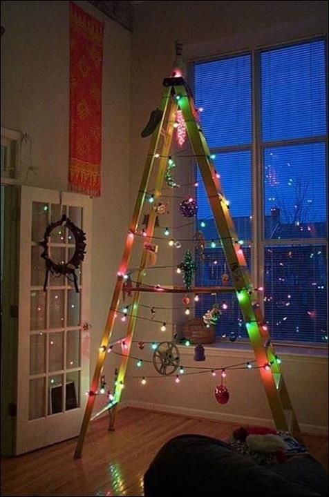 Clever DIY Ladder Lighted Christmas Tree. This is a great for the game room / bachelor pad / modern space.