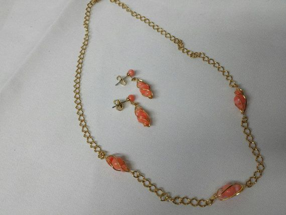 Check out this item in my Etsy shop https://www.etsy.com/ca/listing/266540362/avon-captured-accents-necklace-set-mint