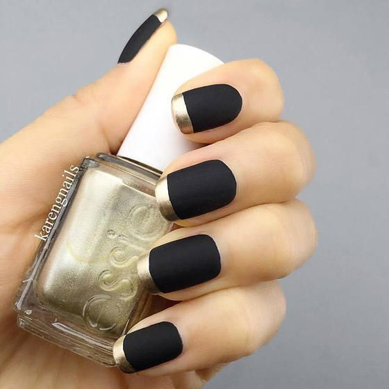 Paint your nails a matte black shade and accentuate them with gorgeous gold tips.