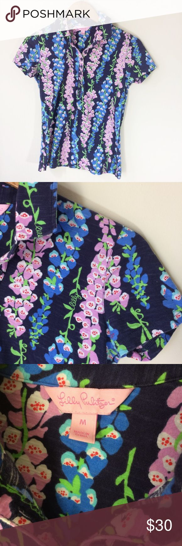 """Lilly Pulitzer Cotton Polo Shirt in Foxglove Lilly Pulitzer Cotton Polo Shirt in Foxglove. Size Medium. Measurements: Armpit to armpit: 16""""/Length: 24.5"""". 100% Cotton. Short sleeves. Lovely print in pink, blue, and green. Like new condition with no flaws, stains, or holes. From a smoke and pet free home. Offers warmly welcomed! Lilly Pulitzer Tops"""