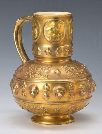 Zsolnay, around 1900, stoneware gilt, embossed décor, encircling lion head décor, minor abraded, minor with craquelure, H. 22.5 cm 16/L180E