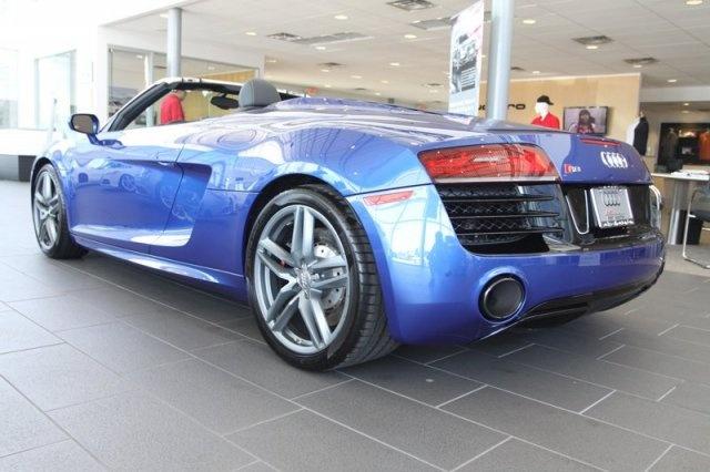 2014 Audi R8  Price: $180,545 VIN: WUATNAFG1EN000109 Stock #: EN000109  V10-Spyder quattro AWD Convertible Transmission: Automatic Color: Sepang Blue Pearl/Black Roof 1 miles