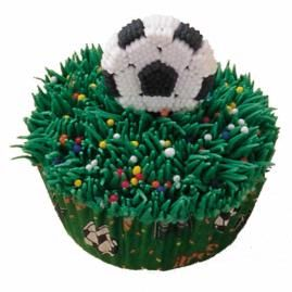 Talk about a field of dreams! A soccer-inspired cupcake decorated with a generous amount of icing and nonpareil sprinkles. Topped with soccer ball icing decoration and baked in color Soccer Baking Cups. This will be the party's Most Valuable Dessert.