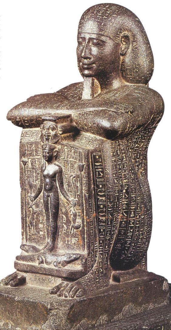 Magical healing statue of Djedhor, basalt (323-317 BC, Ptolemaic Period). It was inscribed with magical spells against snakes and other malign creatures. In its front part, it shows the young god Horus trampling upon crocodiles. (E. Russmann, Egyptian Sculpture: Cairo and Luxor, London 1989, 195).: