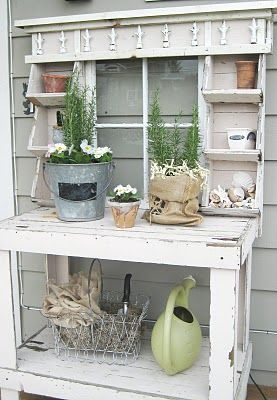 Awesome potting table .... so I made a similiar potting table from pallets... I WILL BE painting it white. I love this. I think I may put it right under my kitchen window too. It is a prominent spot. If it looks this pretty I will love it there!