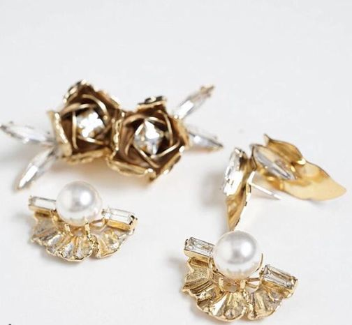 Statement studs in gold, pearl and crystal.