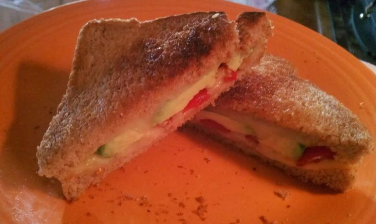 My avocado & tomato grilled Muenster cheese sandwich on wheat.How cute ...