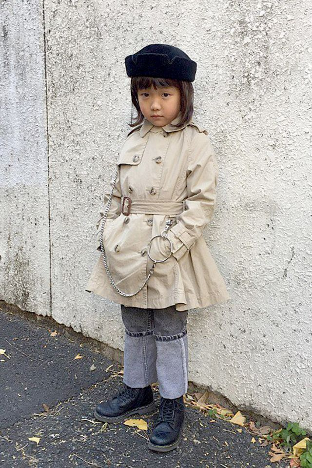 Coco's signature chain belt and combat boots are exactly what allows each of her unique looks to have a bit of cool edge. With a trench coat and retro velvet topper, we're getting late-'90s...