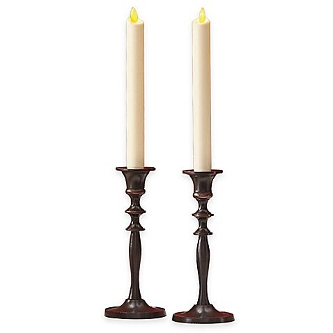 Complement your table setting with the Luminara Real-Flame Effect 8-Inch Battery Operated Taper Candles. These wax dipped taper candles are the perfect, safe alternative to traditional burning candles and provide charming illumination.