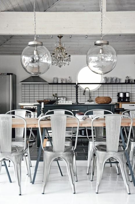 Industrial Kitchen. Tolix chairs & large globe pendants