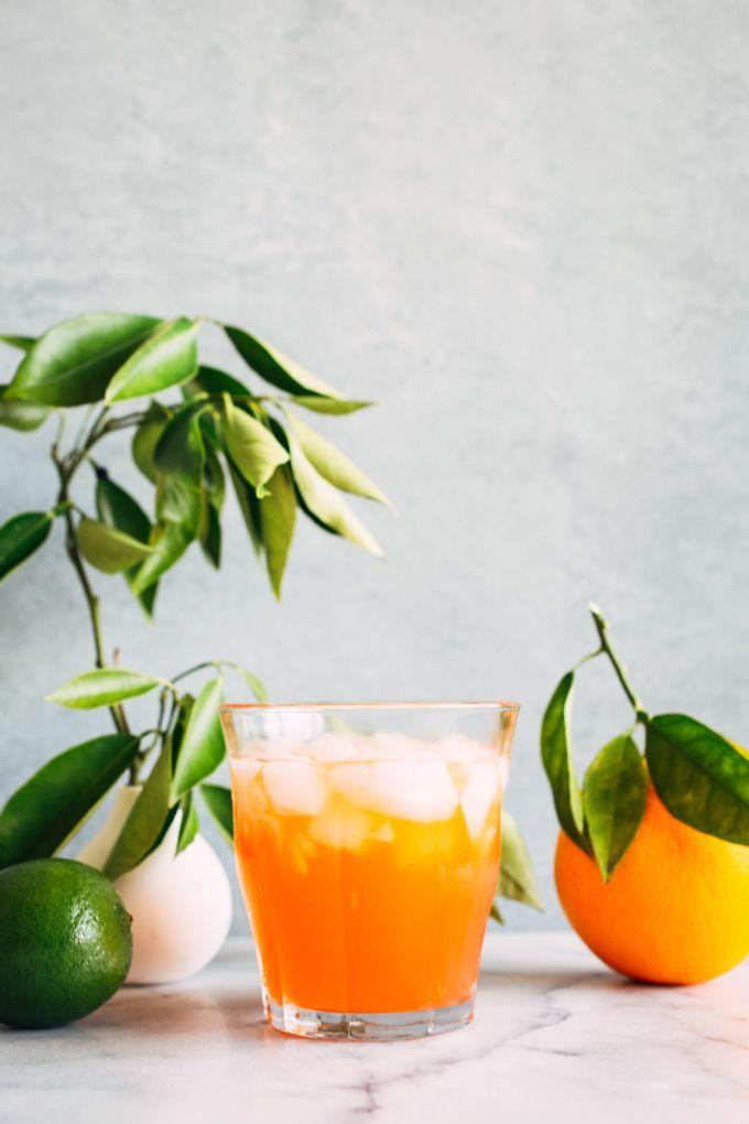 A fresh summer cocktail recipe made with Olmeca Altos Añejo, Aperol, orange liqueur, fresh orange juice and orange bitters.