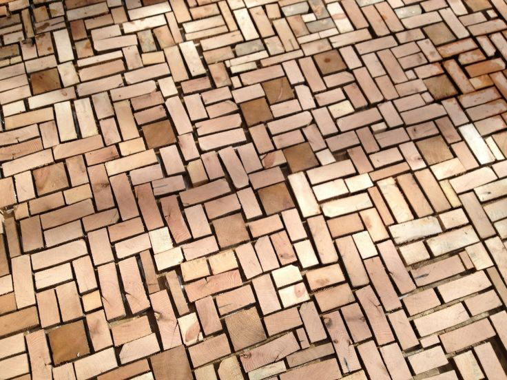 if should do muclh but want a more structured look cutting the ends off wood planks to make wood bricks for a patio or garden floor is an amazing idea