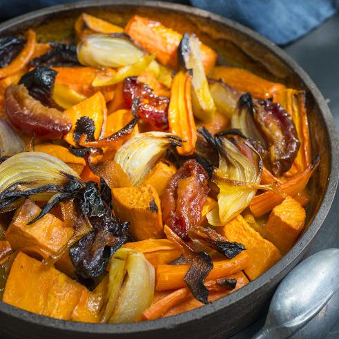 Tzimmes is a popular side dish for Rosh Hashanah and Passover. This updated version with carrots, sweet potatoes, and dried plums is good any day of the year.
