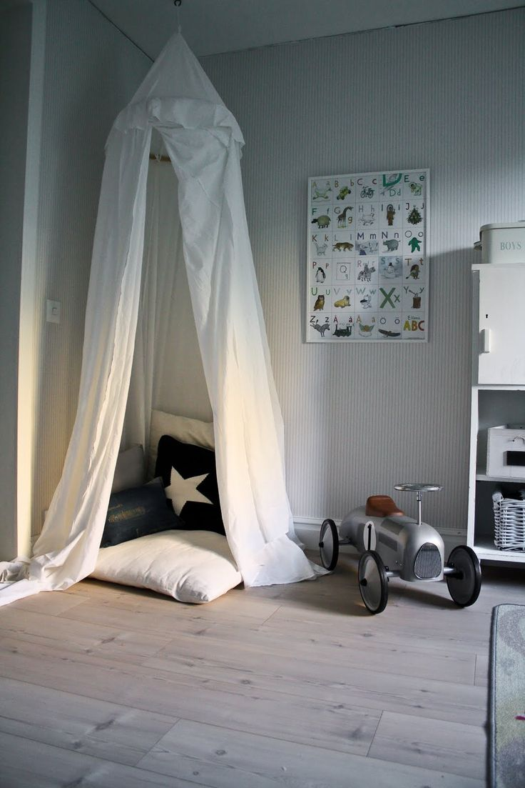 Tented reading nook. Great for a kid's hideaway.