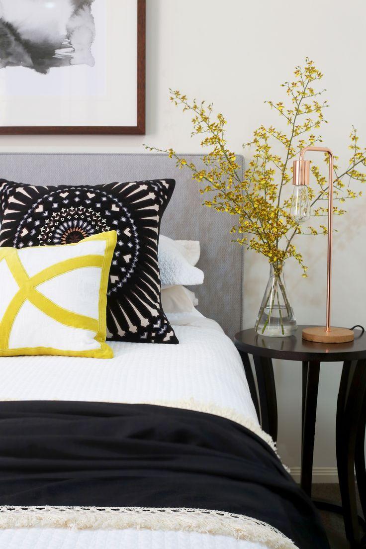Beautiful pop's of yellow & monochromatic guest bedroom by Kim Black Design - Interior Design firm based in Brisbane, Australia.