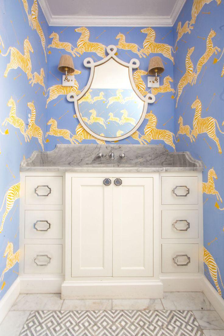 Kid Friendly Bathroom designed by Alexander Interiors. Custom vanity, Carrara marble, Scalamandre gold zebra wallpaper, Ro Sham Beaux white wall sconces with hemp shades, Gabby bone inlay vanity mirror, Nest studio chrome hardware.