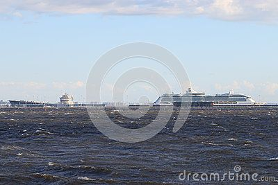 View of the Neva Bay and ships in the passenger port. View from the Park of the 300th anniversary of the city. Saint-Petersburg, Russia