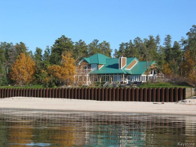 This stunning custom built lakefront home or cottage is situated on a private 1.14 acre property with 122 ft of gorgeous white sand beach across the front.   House is wrapped up in a maintenance free exterior enabling you to enjoy your time at the lake relaxing.  For more information on this property visit www.104lesterlot3.com