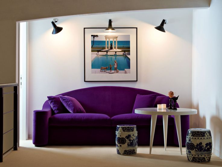Magnificent Modern Furnishing Upholstered Purple Sofa With Spotlight Wall  Fixture And Portrait Living Wall Decor Also Rounded White Table Pistures