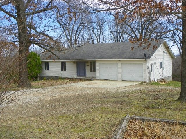 A 3 bedroom, 2 bath, 2 car garage, Ranch style home on approx. 2 ACRES. Home is all electric, has CH/A, double pane windows, county records show a 12 x 14 back deck, 528 sq. ft. garage and 1,584 sq. ft. heated and cooled. The home has vinyl siding, offerings for home include garbage disposal, dishwasher, smooth top cooking range and microwave oven. There is in addition a 30x50 street truss outbuilding.The property is serviced by Rural water.There are several mature shade trees in Green…