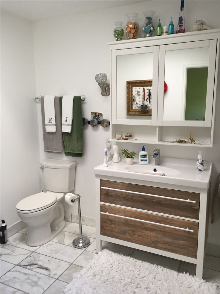 ikea bath vanity was water damaged. i removed the drawer fronts and installed solid wood which will prevent further damage.