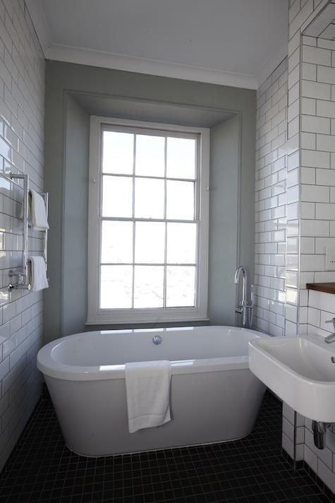 Free standing bath in a small bathroom