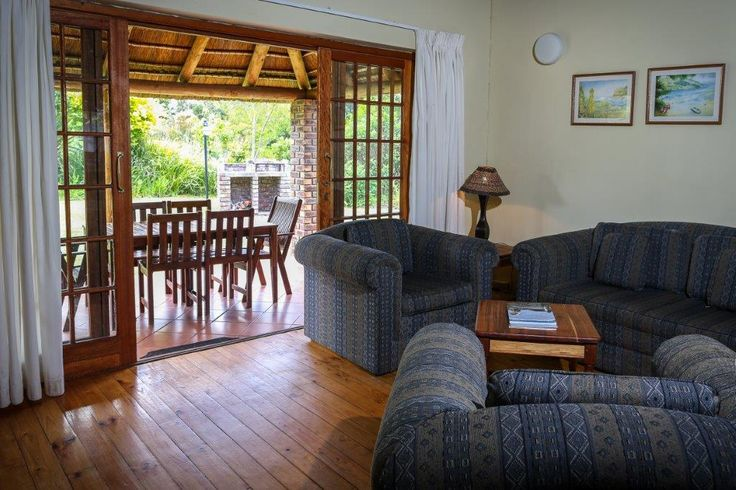 Lounge and outdoor area at Coral Tree Cottages near Plettenberg Bay