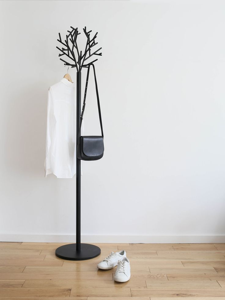 Minimal monochrome styling - black coat stand with white shirt.