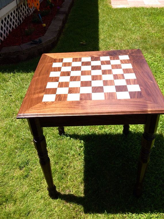 This hard wood chess or checker board table is one of our more popular selling items. It is a unique, high end custom game table that is