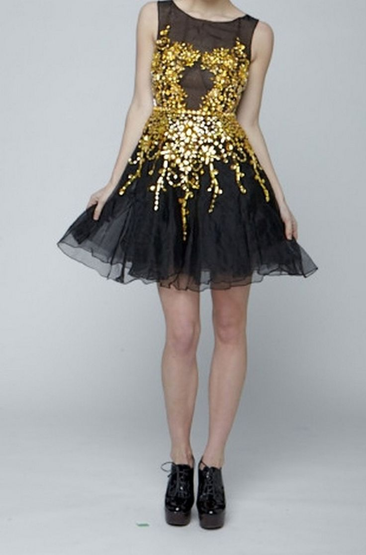Designed by Narces, this short 100% black silk organza full skirt dress features heavy gold bead embellishment.  We dare you not to stare at this gorgeous creation!  Available through www.pinktiger.com.