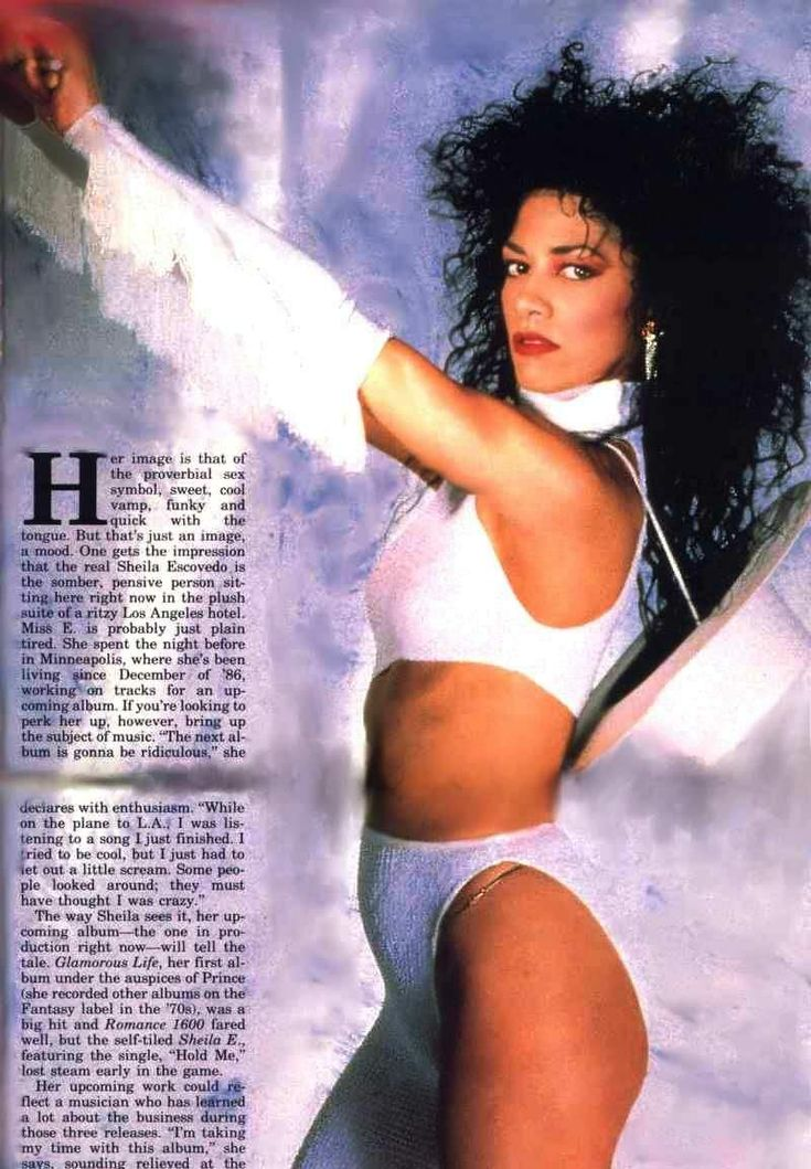 Sheila E 80s   ... probably just about anyone with curly hair rocked this in the 80s lol