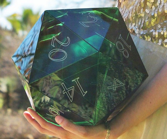 Give your game room a geeky touch befitting a dungeon master of your caliber with this giant D20 dice. The dice is made of a transparent acrylic material and comes in a variety of cool translucent colors - making this a great addition for game night.