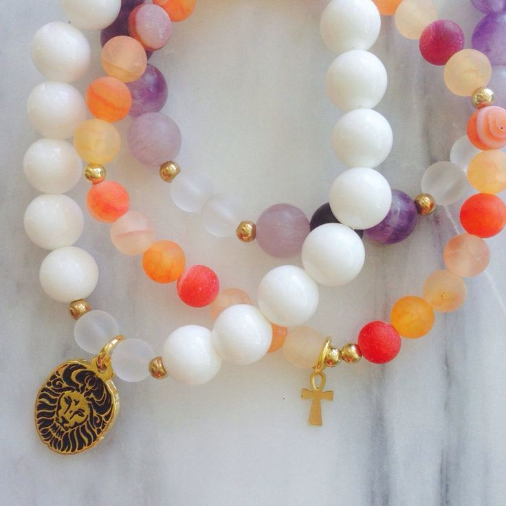 """Beautiful Amethyst, Quartz and Orange Agate """"Transformation"""" Lionheart Bracelet Stack by #MikaMalaPride. Feel lifted and inspired by this healing gemstone bracelet stack created to remind you of your vitality and strength to see your dreams to completion."""