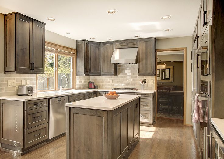Thoughtful Handsome Kitchen Remodel Newly Reconfigured With Chef Friendly Working Spaces A Current Classic Palette Of Alder Gray Stained Cabinetry
