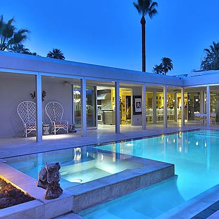 Winter pool and spa in the entry courtyard of this midcentury Palm Springs mansion built on the former Barbara Sutton Estate. Credit: Jim Sanak at Windermere Real Estate