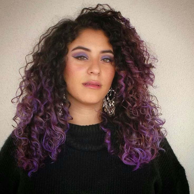 Purple ombre curly hair.