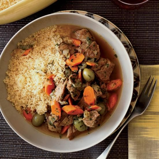 Lamb Tagine with Green Olives and Lemon | The trick to this lower-cost dish is in the seasonings, which transform the lamb into a complexly flavored stew. The dish is vibrantly flavored with ginger, cumin, coriander, olives and lemon; the broth is delicious over couscous. When making most stews, cooks typically brown the meat before braising it; here, chef Ethan Stowell skips that step, which simplifies the Moroccan recipe and gives the lamb a buttery, melt-in-the-mouth texture.
