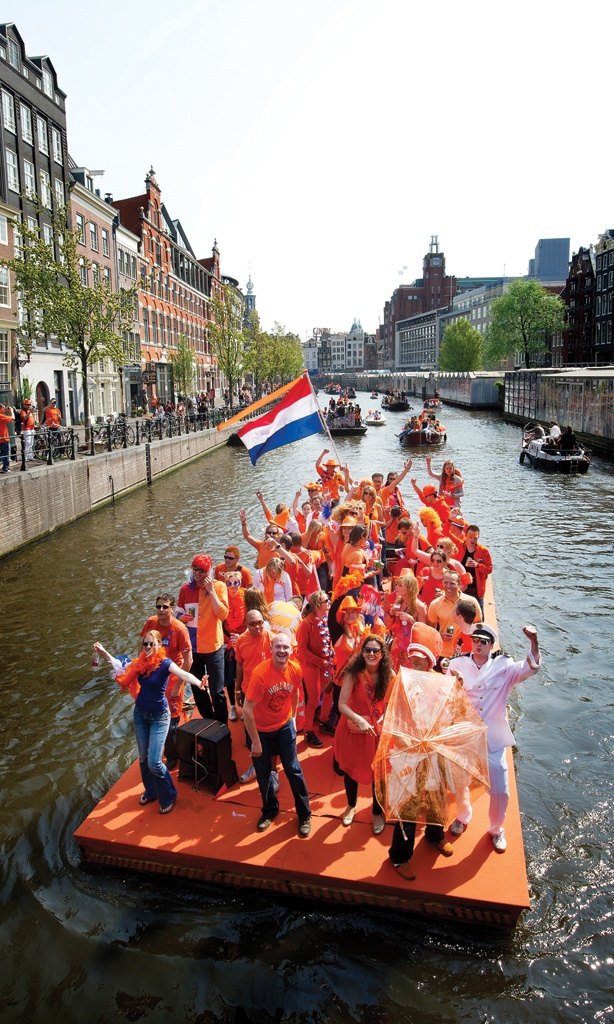 Queen's Day (King's Day from 2014) in #Amsterdam is full of orange! (Photo: Holland.com)