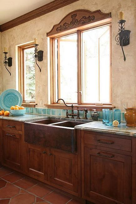 "Inspiration: ""Wrought iron sconces mix easily with oil-rubbed bronze sink faucets as well as the double, hand-hammered Mexican farm sink."""