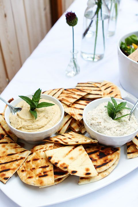 Summer Outdoor Dinner Party; Pita bread and hummus.