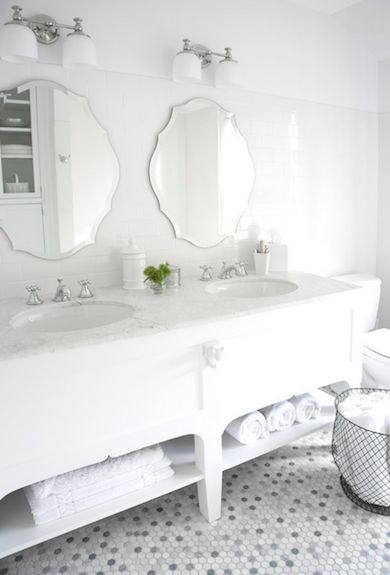 Modern baths are beginning to veer toward a timeless look—black, white, and marble—with penny rounds on the floor, subway tile on the walls, and a soft gray palette overall. White, bright, and fresh—you cant go wrong!