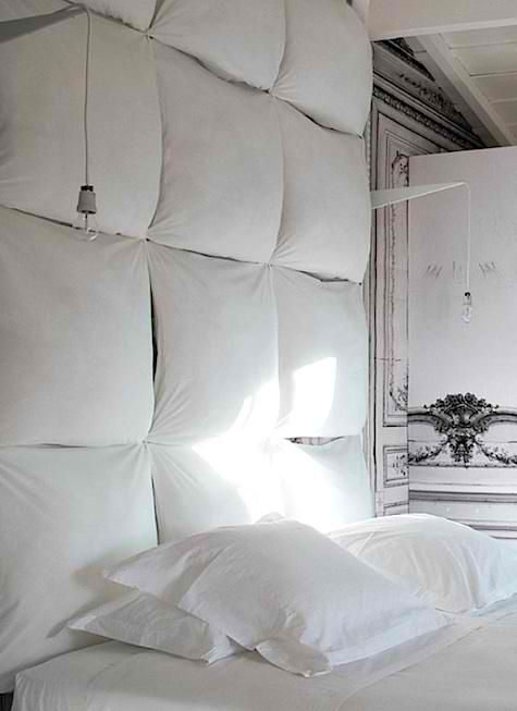 Pillow headboards are giving me ideas, since we're always propping ourselves up against the headboard to watch tv, read, iPad, etc. I like that it's a bit less permanent and a bit more hygienic than upholstered headboards, with just a touch of a padded room joke built in.
