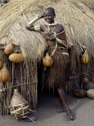 Datoga Woman Relaxes Outside Her Thatched House, Tanzania Photographic Print by Nigel Pavitt at AllPosters.com