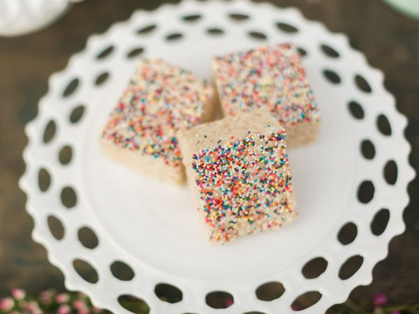 rice krispie treats with sprinkles, photo by Lauren Fair Photography http://ruffledblog.com/stonebrook-farms-bohemian-wedding #desserts