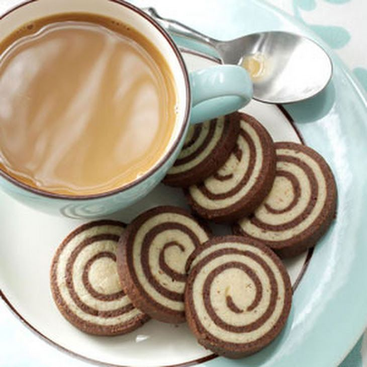 Chocolate-Nut Pinwheel Cookies Recipe Desserts, Afternoon Tea with butter, sugar, eggs, vanilla extract, all-purpose flour, baking powder, salt, ground almonds, almond extract, cocoa